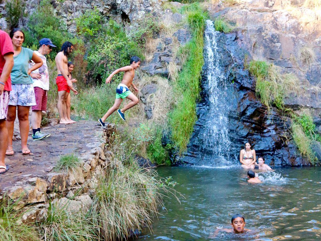 Waterfalls at the river bank at Praia Fluvial do Penedo Furado